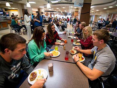 Students enjoy eating lunch in the cafeteria