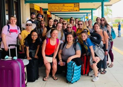 A group of students pose at the airport in Belize
