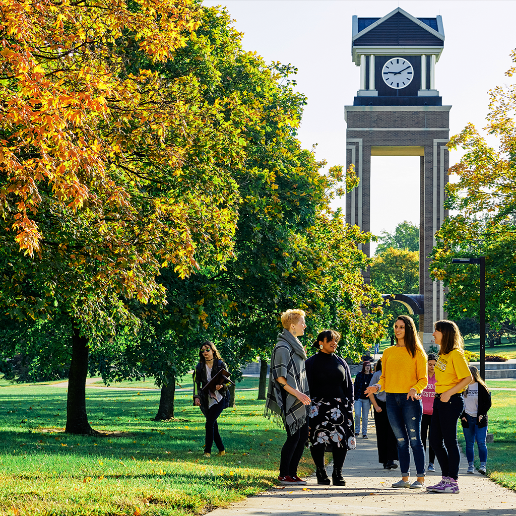 Students standing in front of the missouri western clock tower
