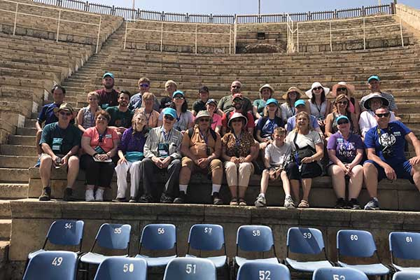 Alumni group at amphitheater in Caesarea