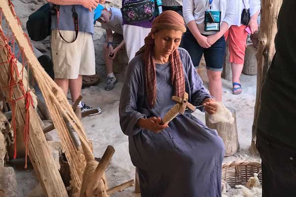 Nazareth- Hannah spins wool into yarn in the first century village.