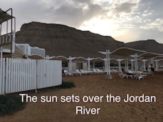 The sun sets over the Jordan River
