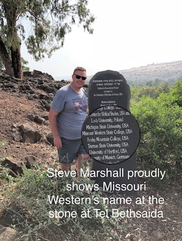 Steve Marshall proudly shows Missouri Western's name at the stone at Tel Bethsaida