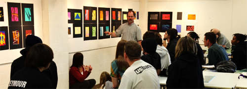 Students in art classroom listening to MWSU professor