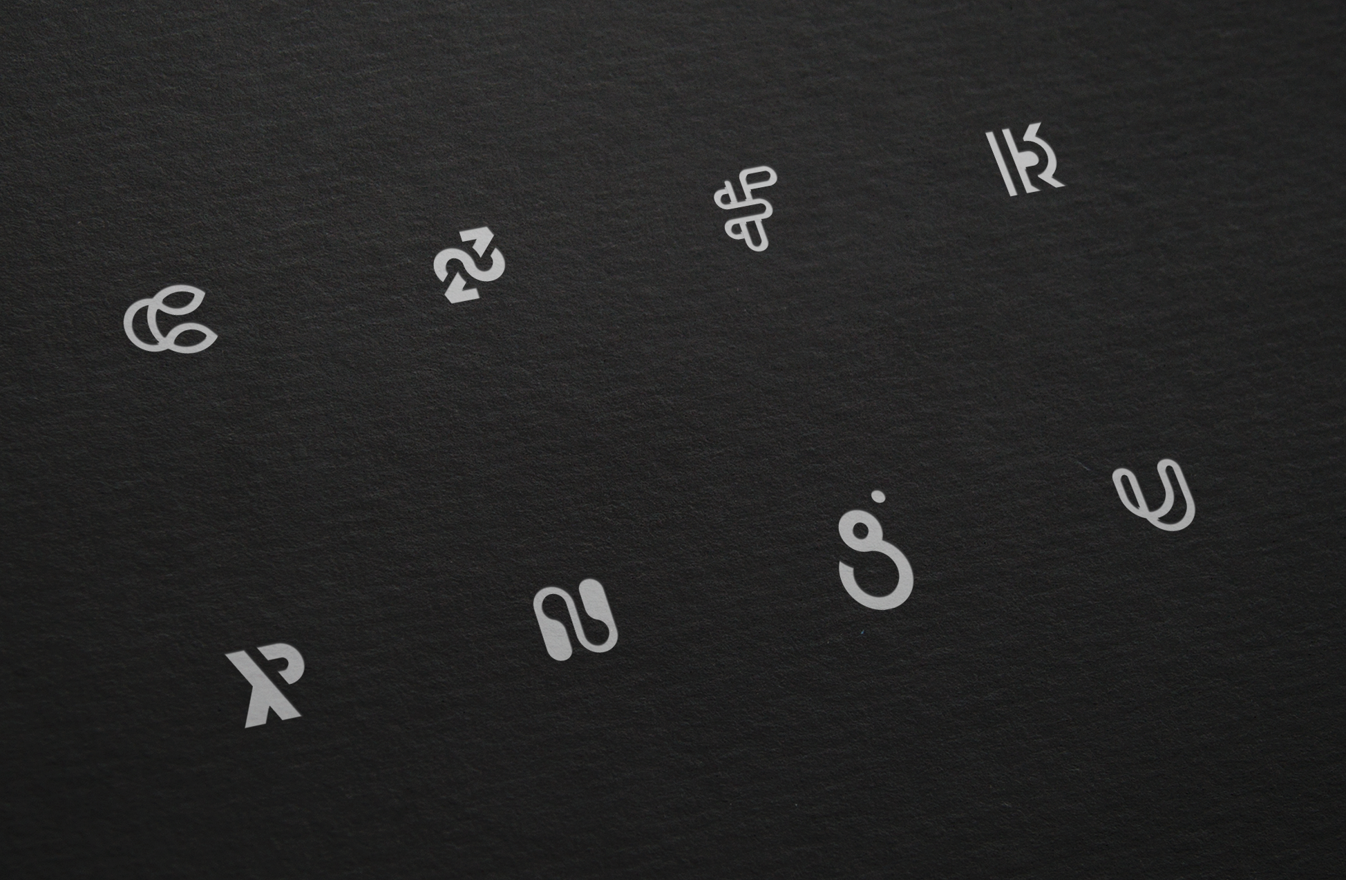 eight icons on embossed on a black page