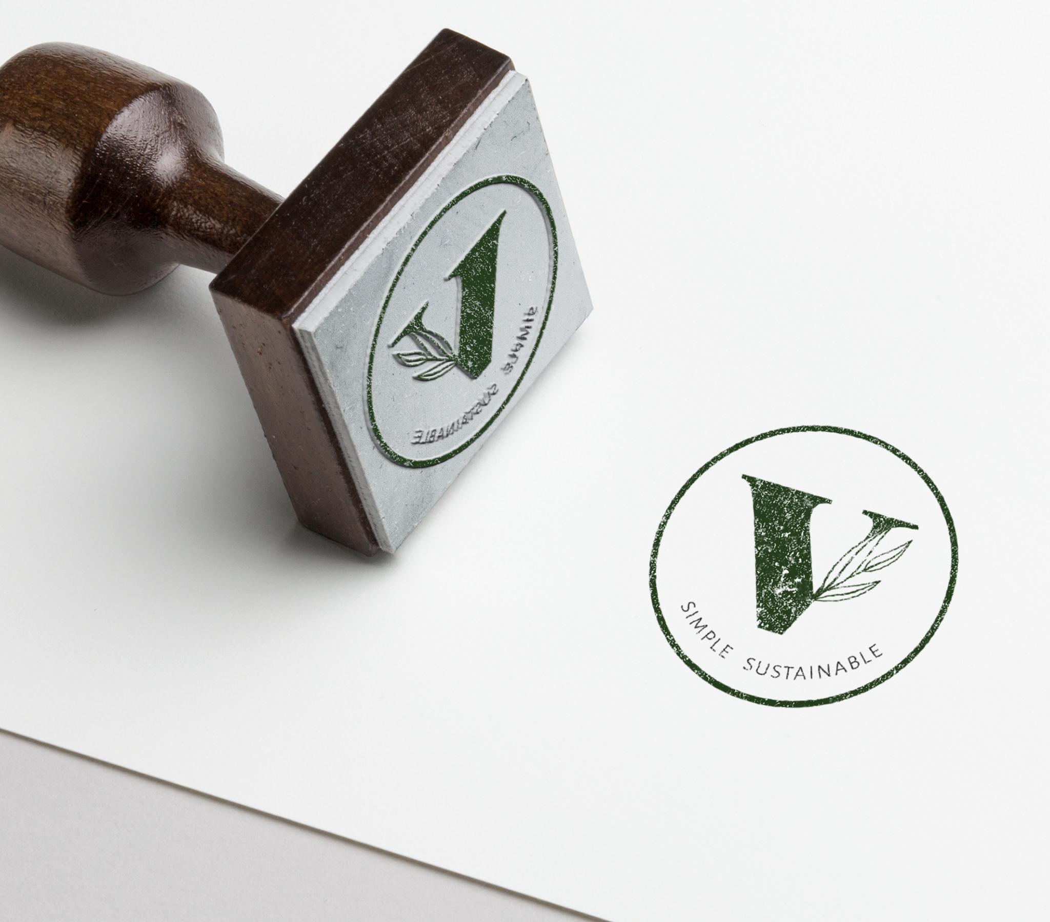 a stamp mockup for a v logo