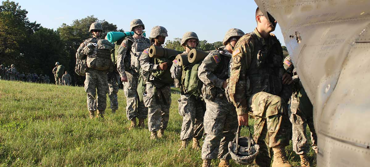 ROTC students load into a helicopter