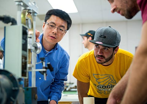 An engineering professor demonstrates equipment