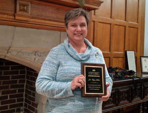 Kaye Adkins receives Distinguished Service Award