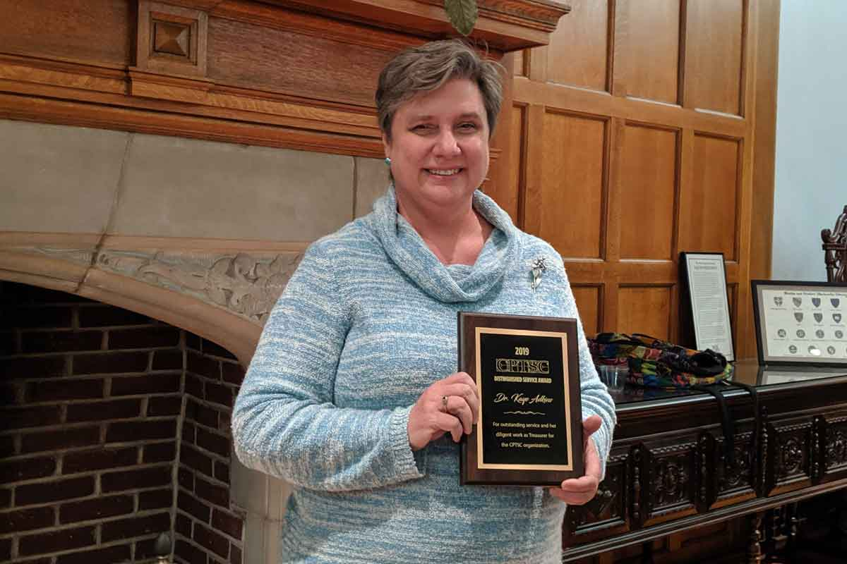Dr. Kaye Adkins with her award