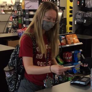 amanda daniel at student store holding a gift card