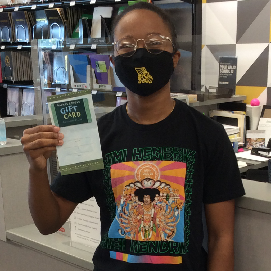 marissa hunt at student store holding a gift card