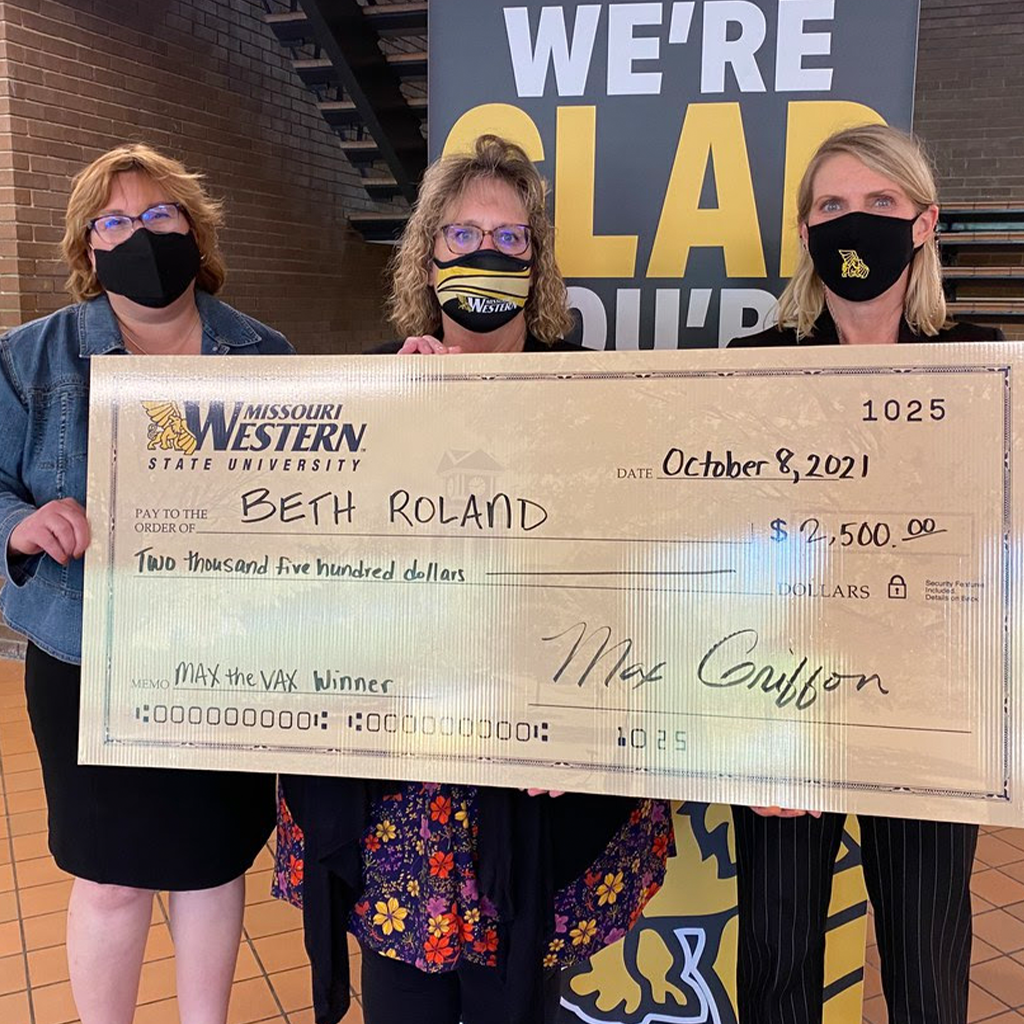 crystal Harris beth roland and elizabeth kennedy holding a big check for twenty-five hundred dollars