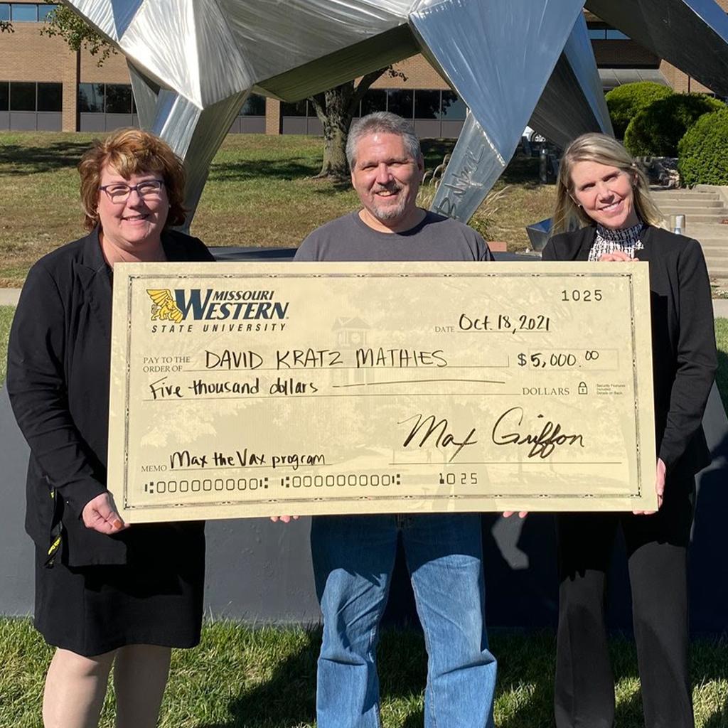 elizabeth kennedy David Kratz Mathies and crystal Harris holding a big check for five-thousand dollars