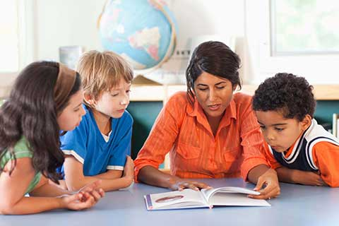 Teacher reading to young students