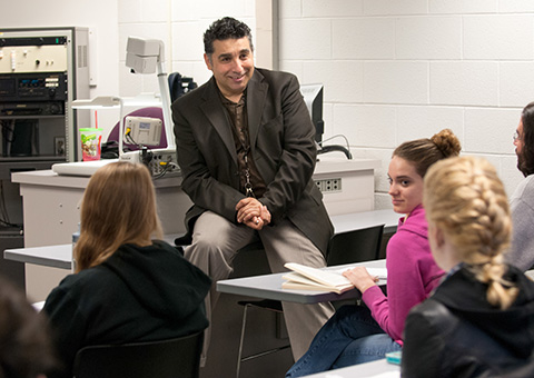 Professor engaged in class discussion with students