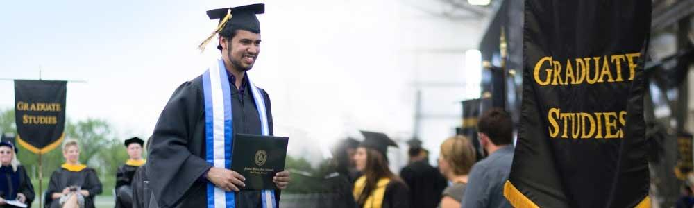 MWSU international graduate student at commencement