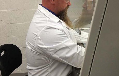 Dr. Grantham working in a biology lab at MWSU