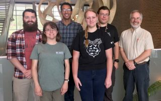 Biology department students with Dr. Carissa Ganong and Dr. Mark Mills