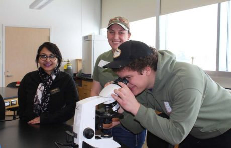 Dr. Tilottama Roy and biology students in the lab