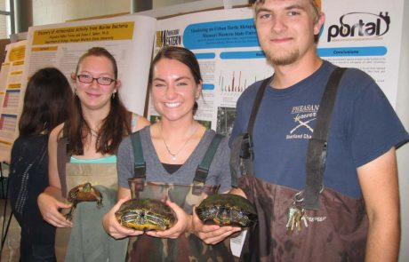 MWSU biology students holding turtles at Portal research day