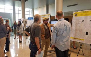 Portal research presentations at Remington Hall Atrium