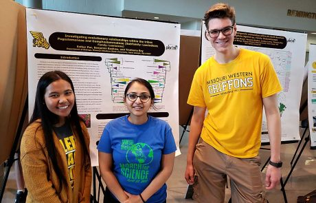 Dr. Tilottama Roy and biology students with research posters