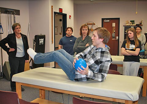 A Physical Therapist Assistant student tries a new exercise technique