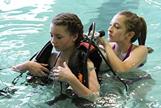 Children learning to scuba dive