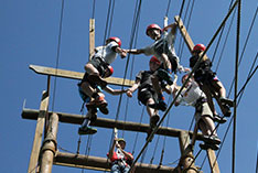 Children manuvering the ropes course