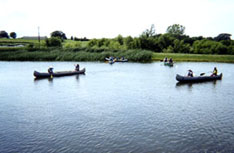 Children canoeing at a campus pond