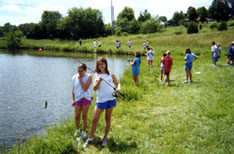 Children fishing at a campus pond
