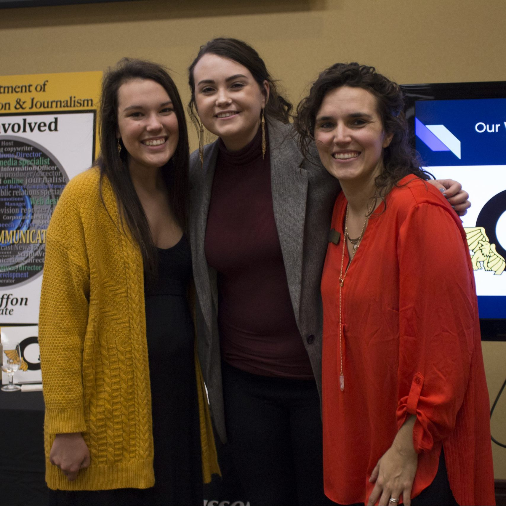 three students presenting work at foundation appreciation reception