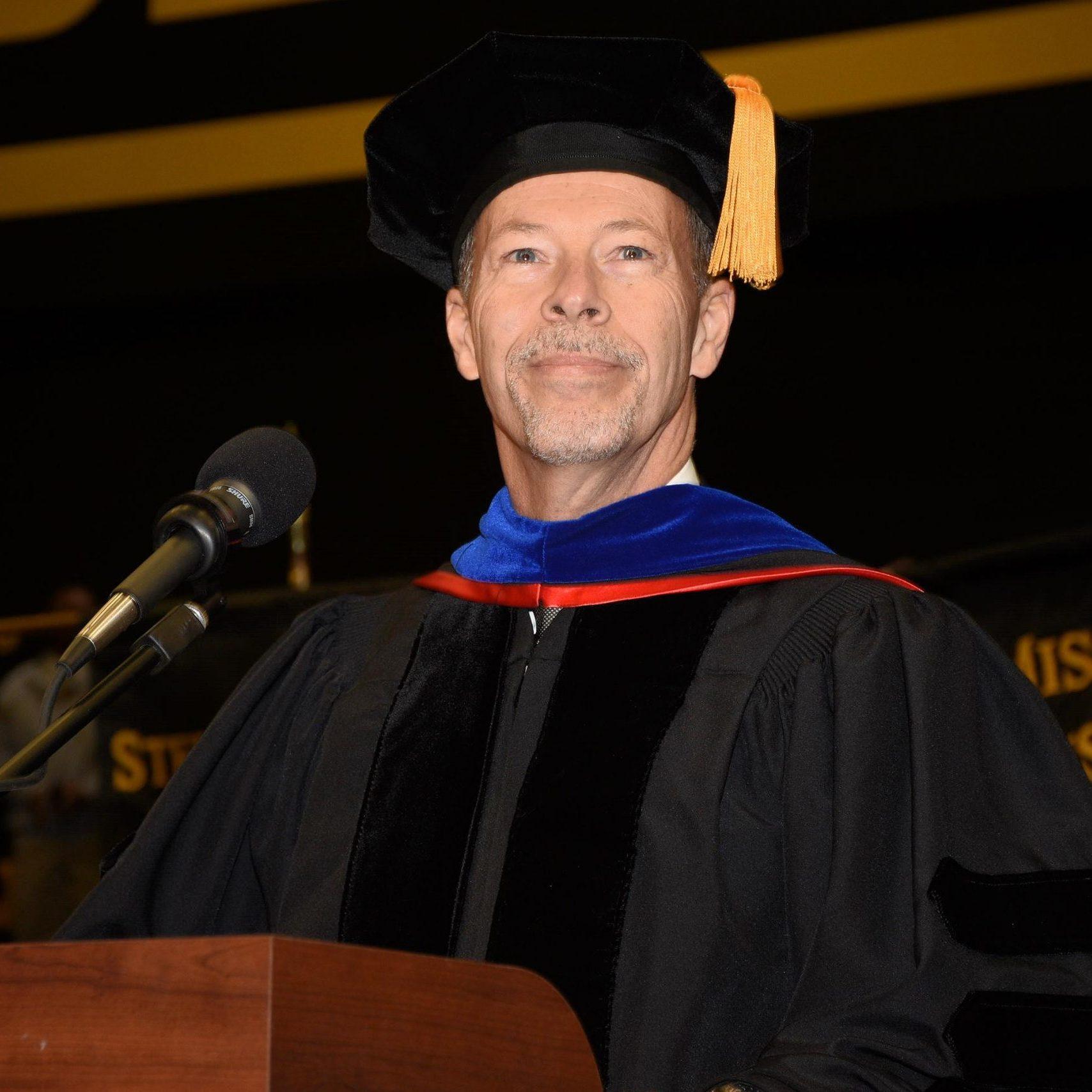 Dr. Doug Davenport standing a podium