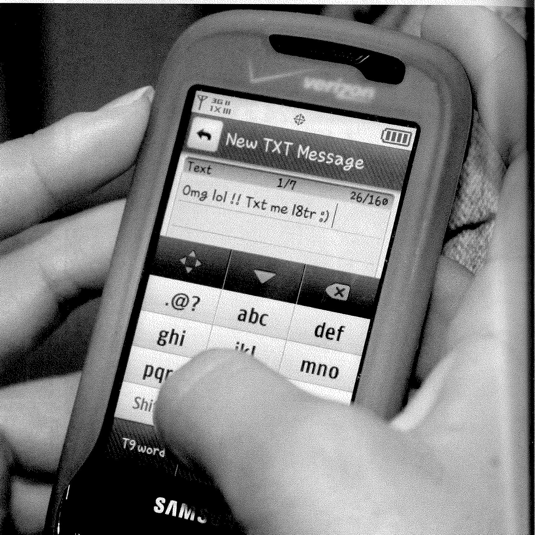 black and white image of a mid-2000s cell phone