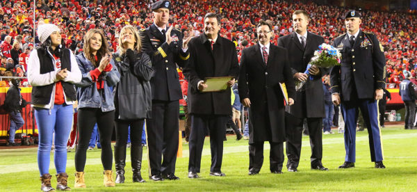 Delegates from Missouri Western and Heroes United present a scholarship to Taylor and Landry Collins during half-time at the Kansas City Chiefs' Salute to Service game on October 30, 2017.