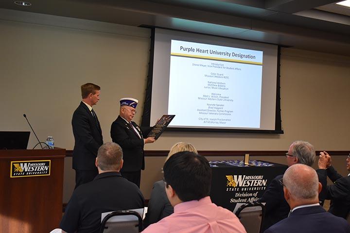 Missouri Western president Matt Wilson accepts the Purple Heart University designation