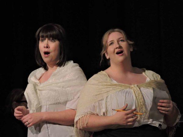 Two opera singers singing