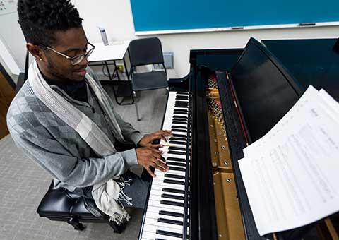 MWSU music student playing piano