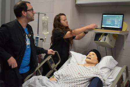 two nursing students tend to a patient mannequin in MWSU nursing simulation lab.
