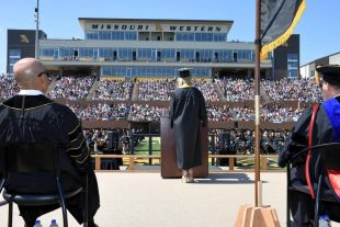 student speaker addresses crowd at commencement ceremony