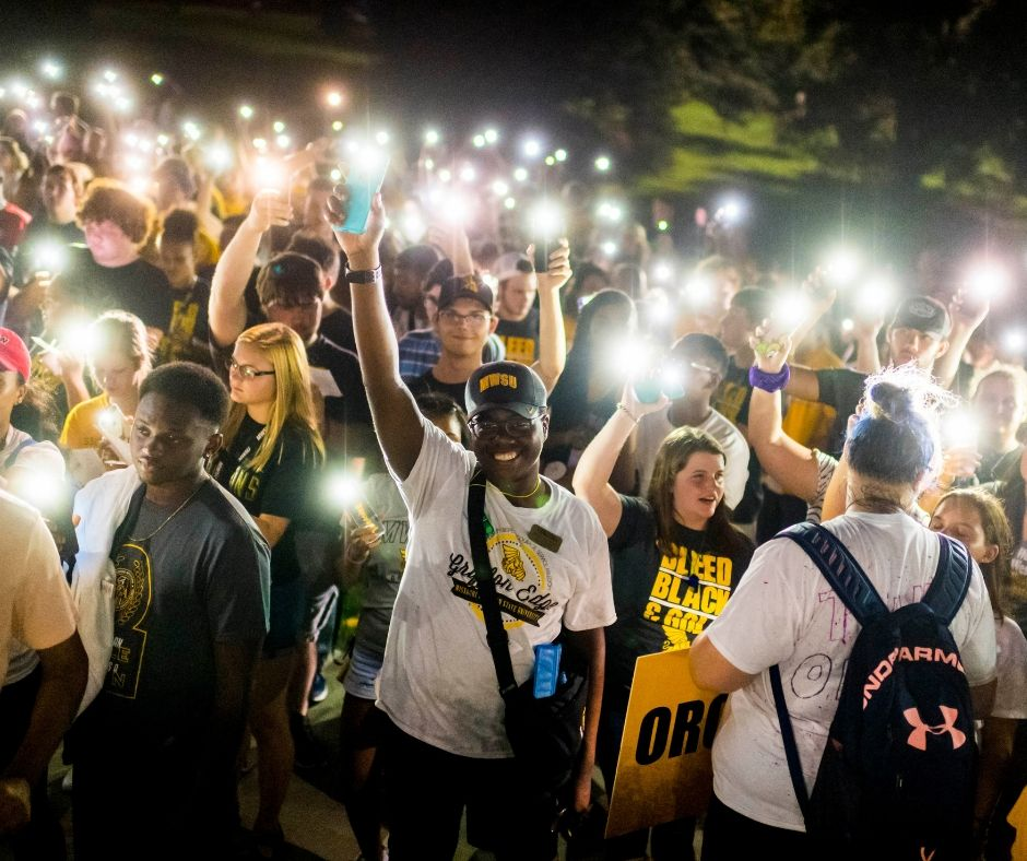 "freshmen hold their lit phones above their heads in a ""candlelight"" ceremony"