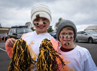 two young fans in Griffon gear at the Homecoming Tailgate