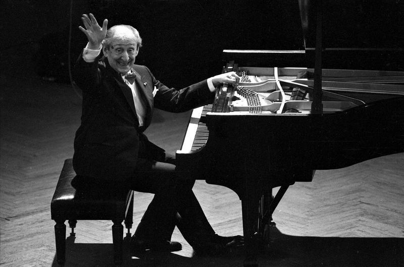 Vladamir Horowitz waves from the keyboard of his Steinway piano