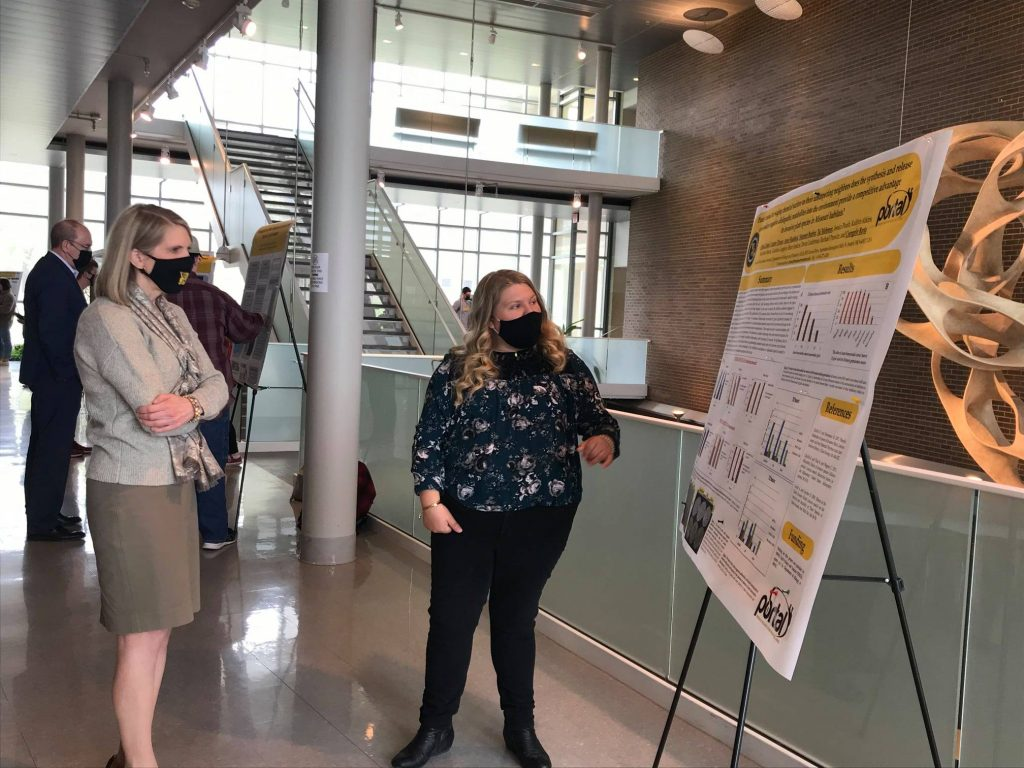 biology student explains research poster