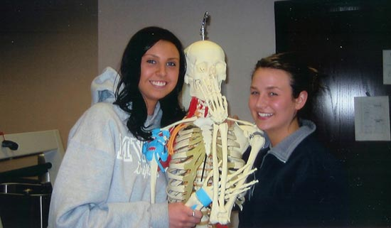 Students pose with a skeleton