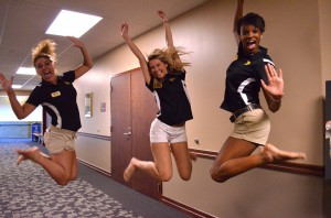 Students jumping in a residence hall.