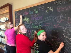 Living community students draw on a chalkboard
