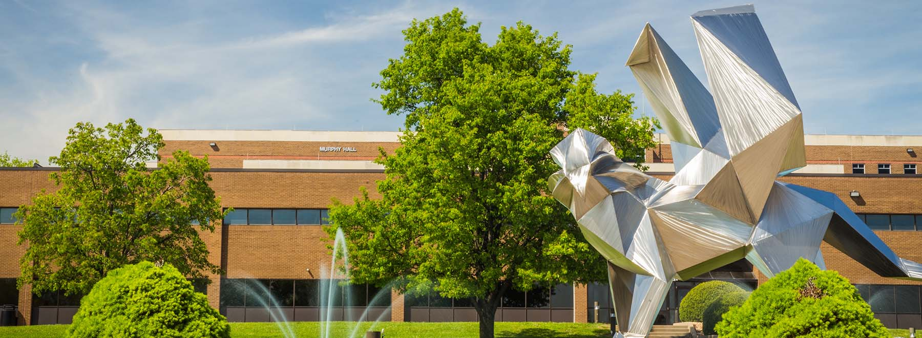 Griffon statue in front of Eder Hall