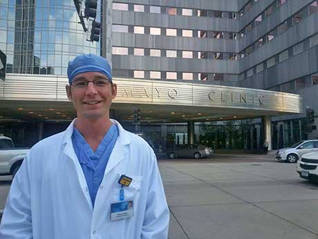 Student Michael Balak stands in front of Mayo Clinic